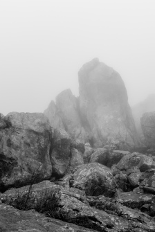 "Further up in the ""Picos de Europa"" we find these old rock formations that wrapped in the fog look like ghosts of a convulsive time in which they were created. (Mas arriba en los ""Picos de Europa"" nos encontramos estas antiguas formaciones rocosas que envueltas en la niebla parecen fantasmas de una epoca convulsa en la que se creron)."
